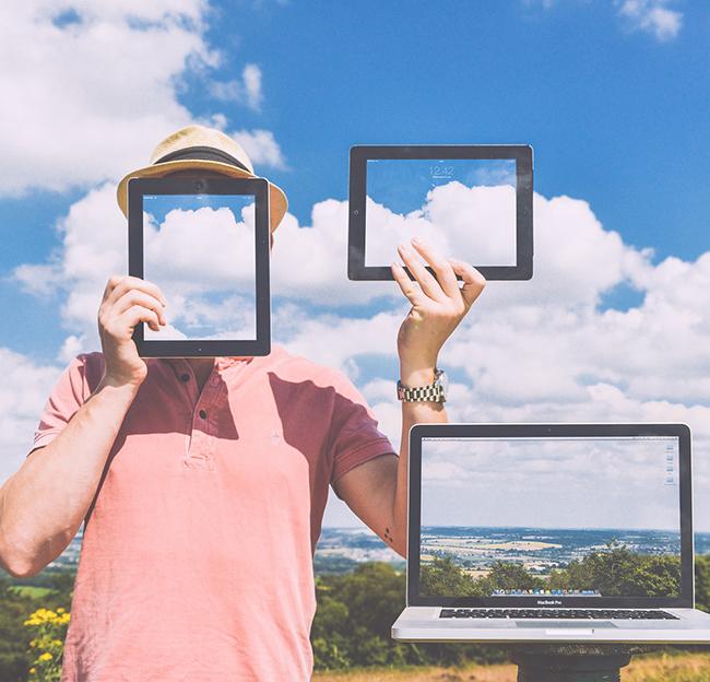 Cloud Soltions image - man, computers cloud